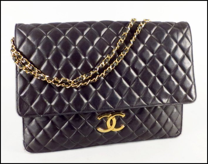 CHANEL BLACK QUILTED LEATHER HANDBAG.