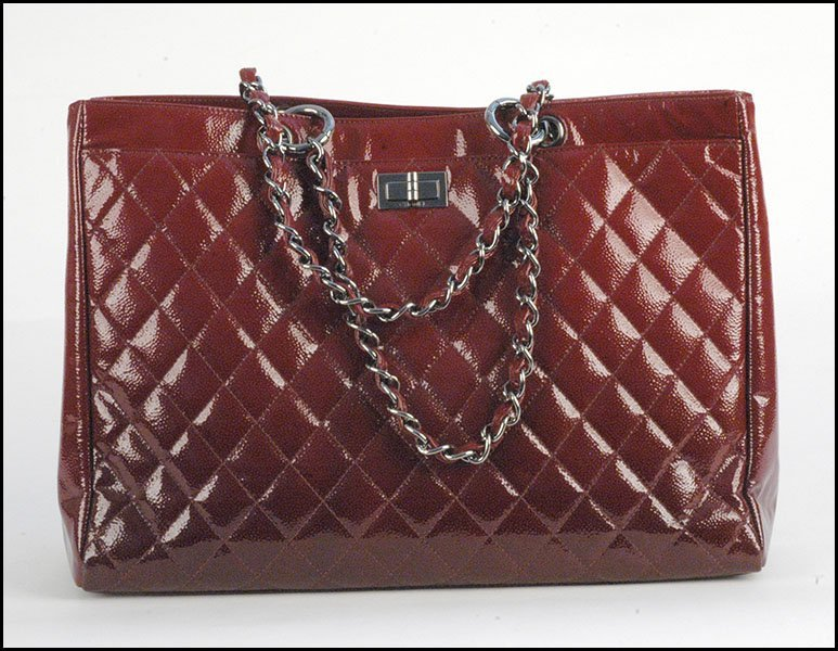 CHANEL RED QUILTED PATENT LEATHER TOTE.
