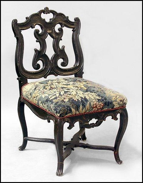 CONTINENTAL CARVED MAHOGANY SIDE CHAIR.