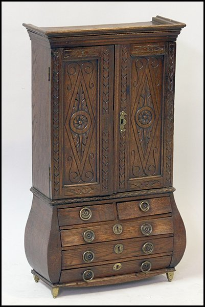 DIMINUTIVE CARVED OAK CABINET.