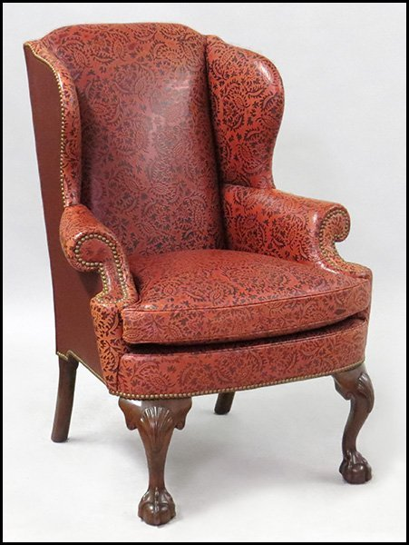 KITTINGER RED LEATHER UPHOLSTERED WINGBACK CHAIR.