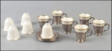 SET OF SIX STERLING SILVER DEMITASSE CUPS AND SAUCERS