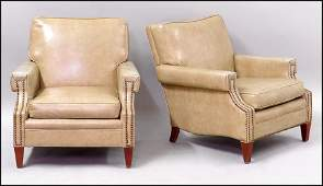 PAIR OF VINYL UPHOLSTERED CLUB CHAIRS.