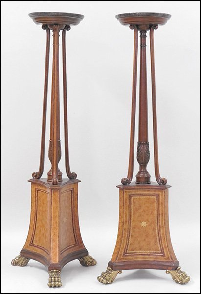 PAIR OF CARVED MAHOGANY PEDESTAL STANDS.