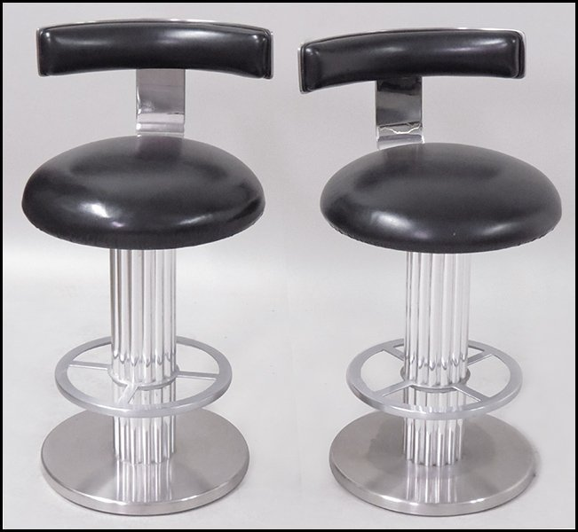 SET OF FIVE STAINLESS STEEL SWIVEL STOOLS.