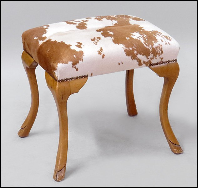 WILLIAM SWITZER MAPLE AND COW HIDE STOOL.