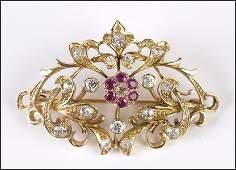 EDWARDIAN DIAMOND, RUBY, AND 14 KARAT YELLOW GOLD BROO