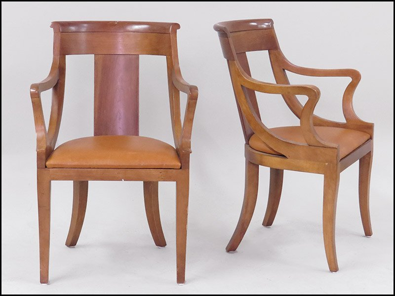 PAIR OF MAPLE OPEN ARMCHAIRS.