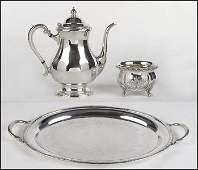 THREE-PIECE INTERNATIONAL SILVER TEA SERVICE.