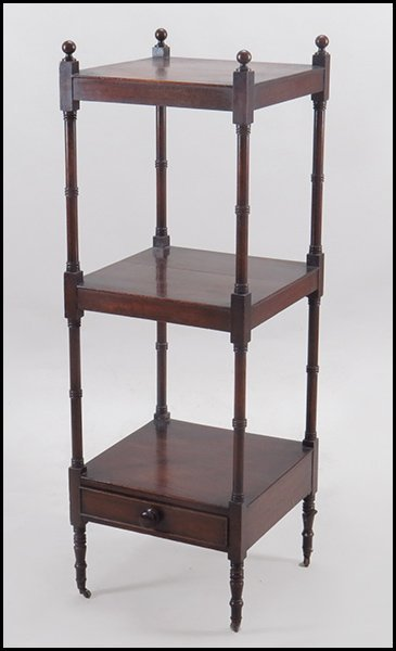 WILLIAM IV MAHOGANY THREE TIERED STAND.