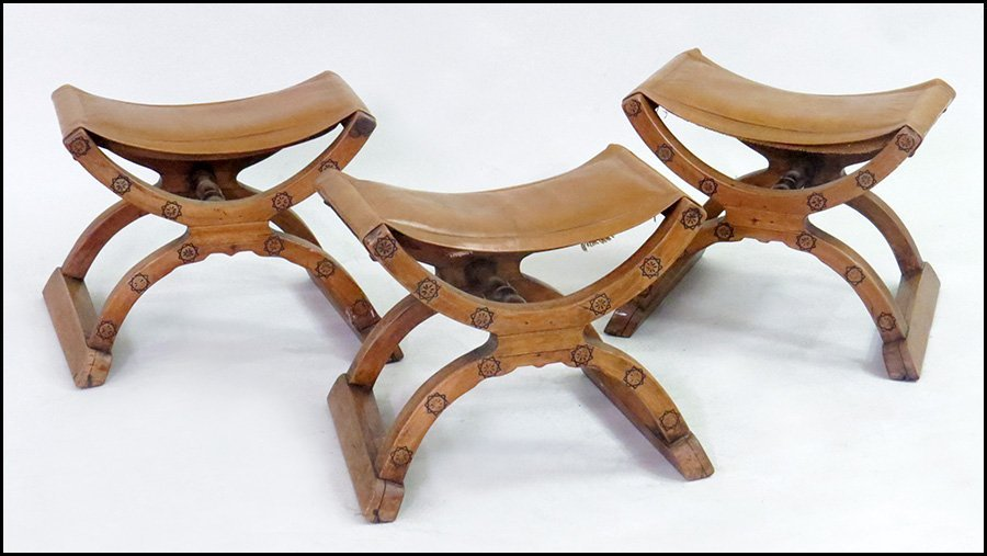 SET OF THREE LEATHER AND WOOD SPANISH SADDLE FORM CHAIR