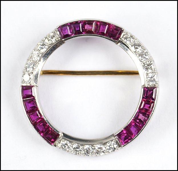 RUBY, DIAMOND, AND PLATINUM CIRCLE BROOCH.