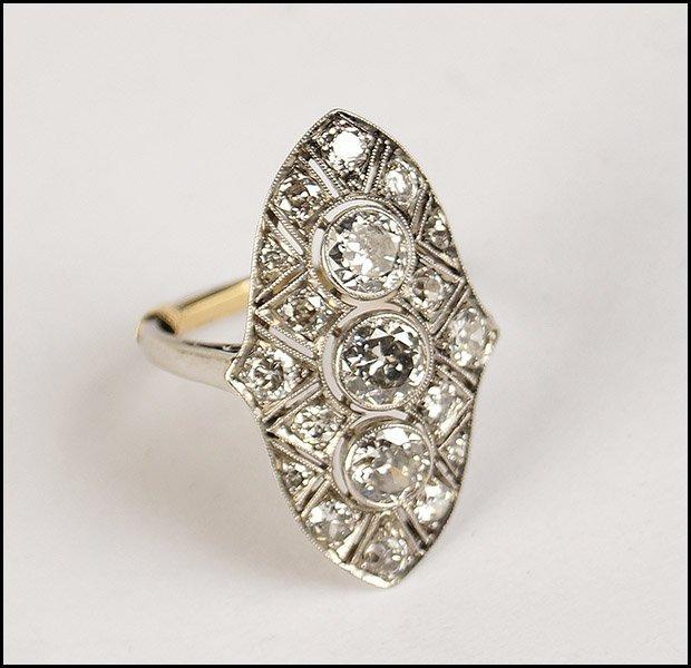ART DECO DIAMOND AND FILIGREE PLATINUM RING.