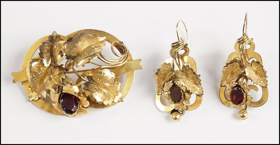 VICTORIAN GARNET AND 14 KARAT YELLOW GOLD DEMI-PARURE.