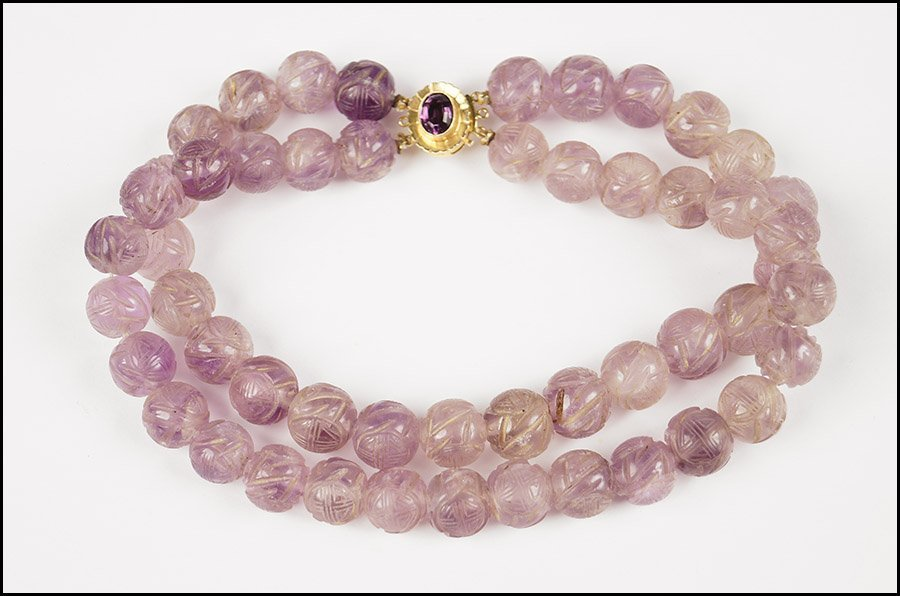 CARVED AMETHYST BEAD TWO-STRAND NECKLACE.
