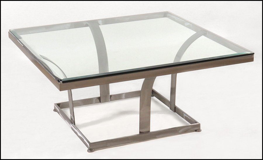 BRUSHED STAINLESS STEEL AND GLASS COCKTAIL TABLE.
