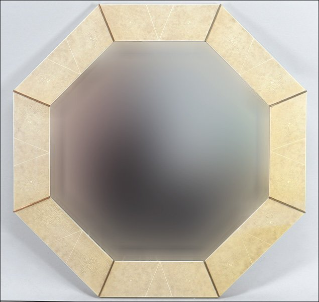 A CONTEMPORARY OCTAGONAL SHAGREEN MIRROR.