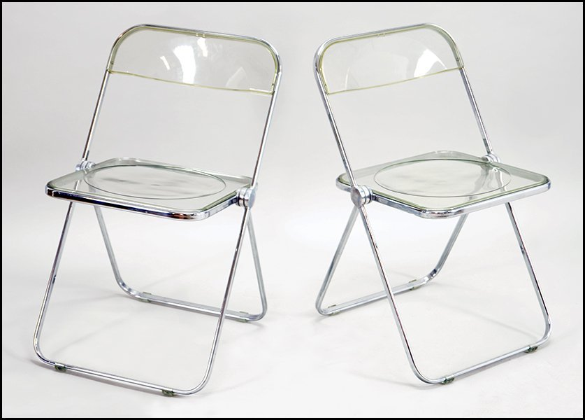 SET OF FOUR LUCITE FOLDING CHAIRS.