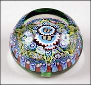 A PERTHSHIRE FACETED GLASS PAPERWEIGHT