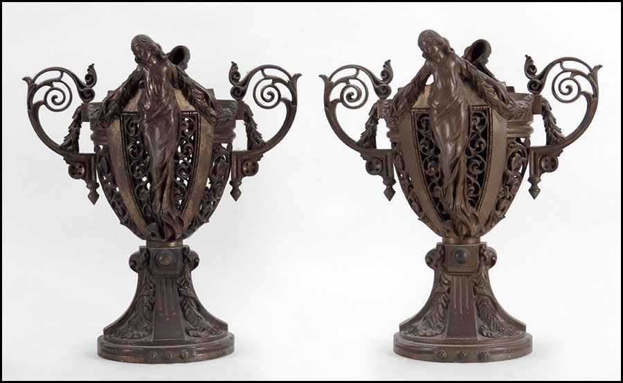 PAIR OF PATINATED METAL CHALICE FORM URNS.