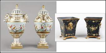 PAIR OF GILT AND PAINTED CERAMIC LIDDED URNS.