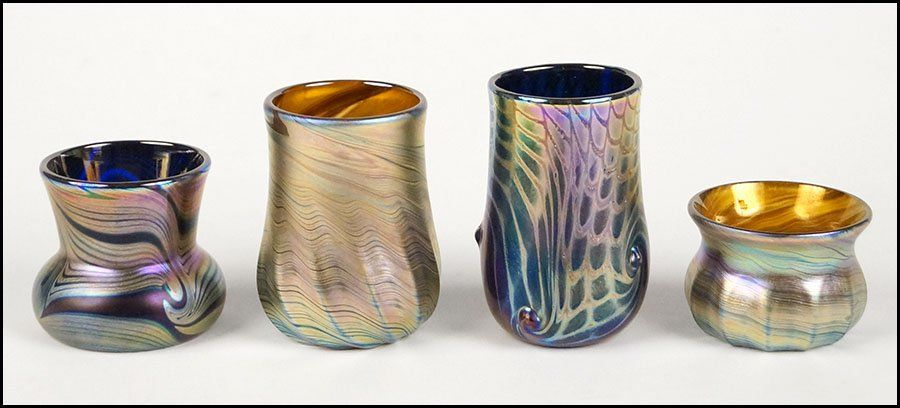FOUR UNSIGNED FAVRILE ART GLASS CABINET VASES.