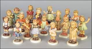 GROUP OF EIGHTEEN GOEBEL HUMMEL PORCELAIN FIGURES