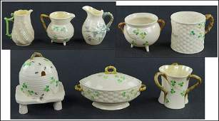 COLLECTION OF BELLEEK PORCELAIN TABLE ARTICLES IN THE
