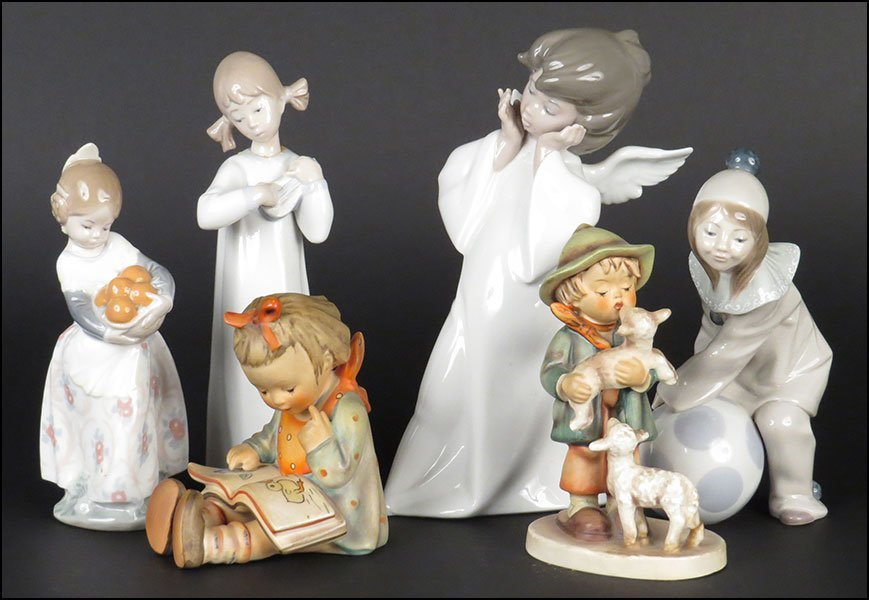 GROUP OF FOUR LLADRO PORCELAIN FIGURES.