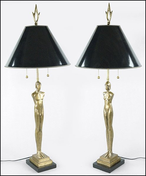 A PAIR OF TOM CORBIN PATINATED BRONZE TABLE LAMPS.