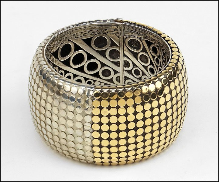 A JOHN HARDY STERLING SILVER AND 18 KARAT YELLOW GOLD