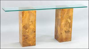 A CONTEMPORARY GLASS TOP CONSOLE TABLE