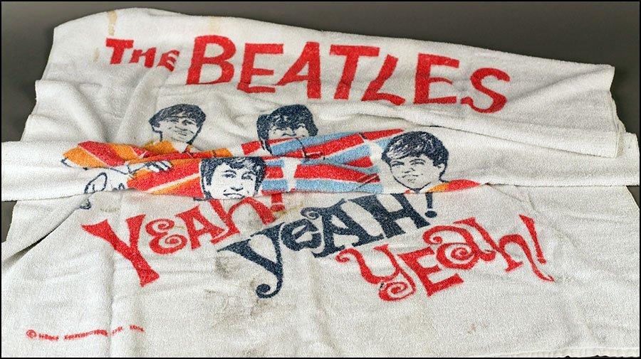 A 'THE BEATLES' BEACH TOWEL.