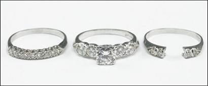 A PLATINUM AND DIAMOND RING SET