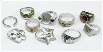 A GROUP OF TEN STERLING SILVER RINGS