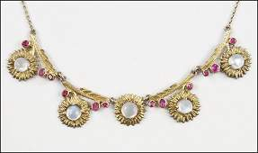 A MOONSTONE RUBY AND 14 KARAT YELLOW GOLD NECKLACE