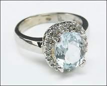 AN AQUAMARINE DIAMOND AND 10 KARAT WHITE GOLD RING