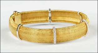 A ROBERTO COIN 18 KARAT YELLOW GOLD AND DIAMOND BRACELE