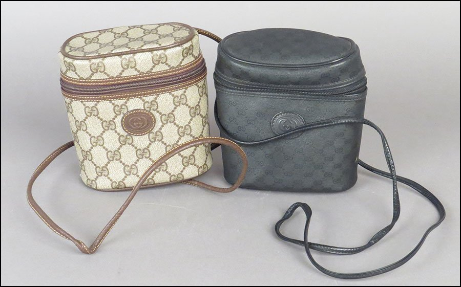 TWO GUCCI SIGNATURE LEATHER BINOCULAR SHOULDER BAGS.