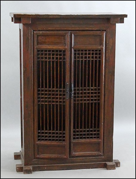 CHINESE STAINED WOOD TWO-DOOR CABINET.