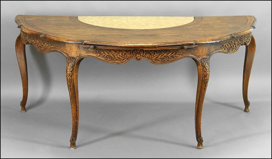 FRENCH PROVINCIAL STYLE CARVED OAK WINE TASTING TABLE.