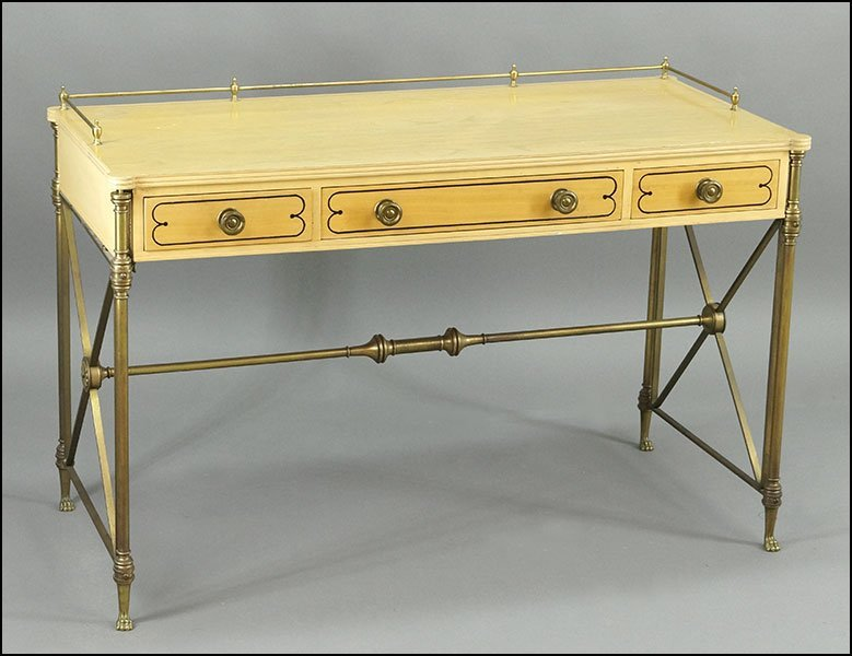 A KITTINGER BLONDE WOOD AND PATINATED METAL DESK.