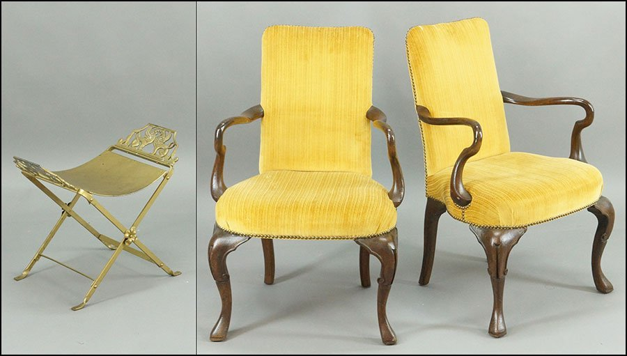 A PAIR OF CARVED MAHOGANY UPHOLSTERED OPEN ARMCHAIRS.