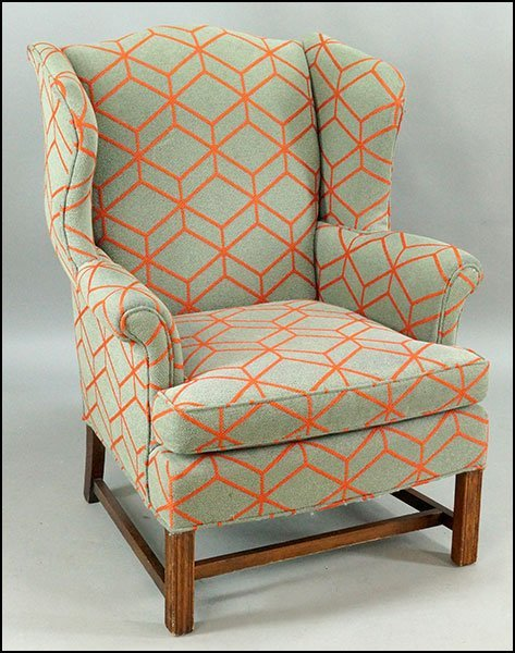 CONTEMPORARY UPHOLSTERED WINGBACK ARMCHAIR.
