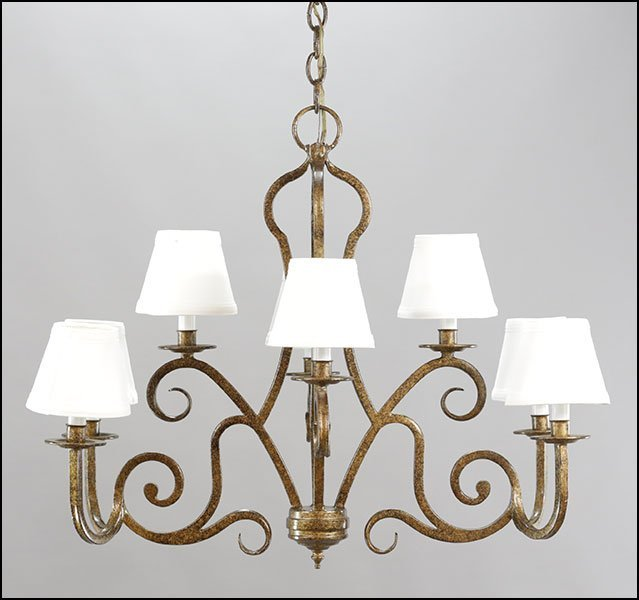 A CONTEMPORARY BRUSHED METAL EIGHT-LIGHT CHANDELIER.