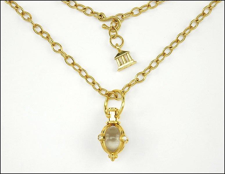 A TEMPLE ST. CLAIR DIAMOND, 18 KARAT YELLOW GOLD, AND