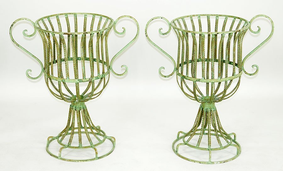 A Pair Of Green Painted Metal Planters.