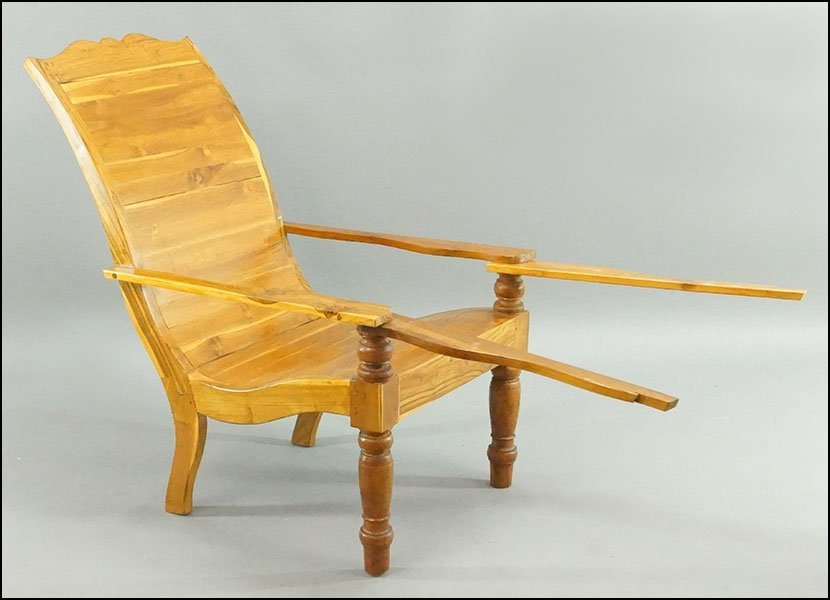 A Pair of Indonesian Lounge Chairs.