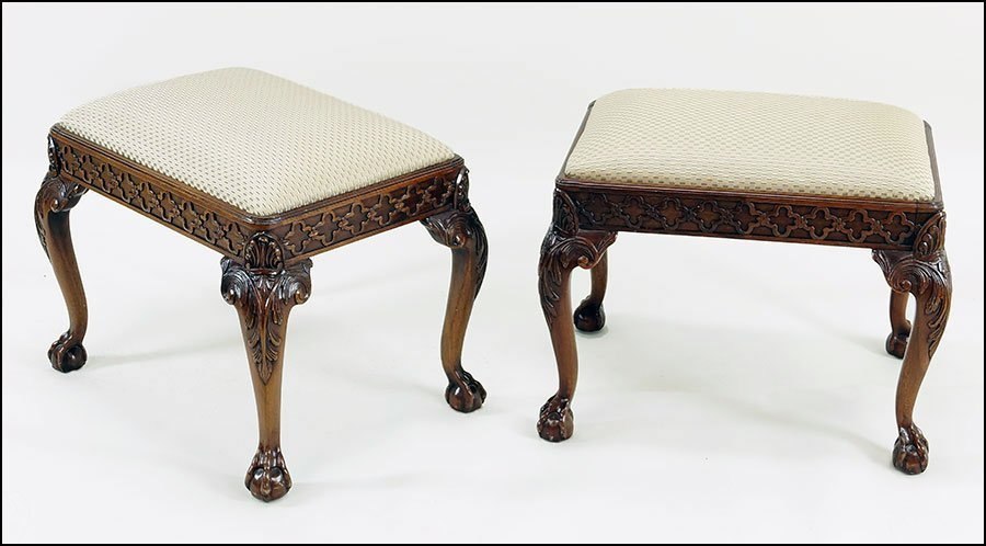 A Pair Of Georgian-Style Carved Mahogany Stools.