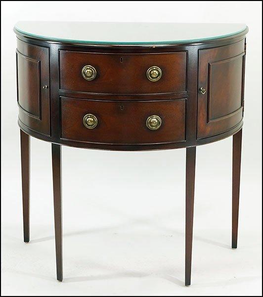 A Baker Mahogany Demilune Table.